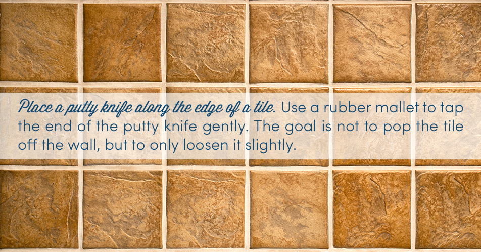 Place a putty knife along the edge of a tile. Use a rubber mallet to tap the end of the putty knife gently. The goal is not to pop the tile off the wall, but to only loosen it slightly.