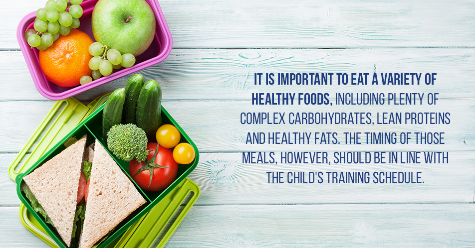 It is important to eat a variety of healthy foods, including plenty of complex carbohydrates, lean proteins and healthy fats. The timing of those meals, however, should be in line with the child's training schedule.