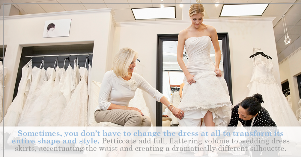Sometimes, you don't have to change the dress at all to transform its entire shape and style. Petticoats add full, flattering volume to wedding dress skirts, accentuating the waist and creating a dramatically different silhouette.