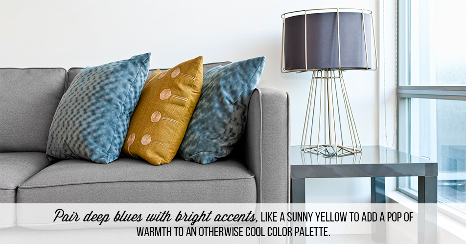 Pair deep blues with bright accents, like a sunny yellow to add a pop of warmth to an otherwise cool color palette.